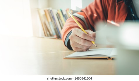 high school,university student study.hands holding pencil writing paper answer sheet.sitting lecture chair taking final exam attending in examination classroom.concept scholarship for education abroad