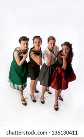 High Shot of Four Young Ladies Blowing a Kiss