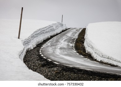 High snow wall and mountain road Aurlandsvegen between Aurland and Laerdal in Norway, summer time