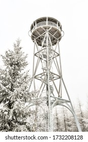 High, snow-covered lookout tower on the top of the Jagodna mountain, winter season. Lookout point on the hiking trail.