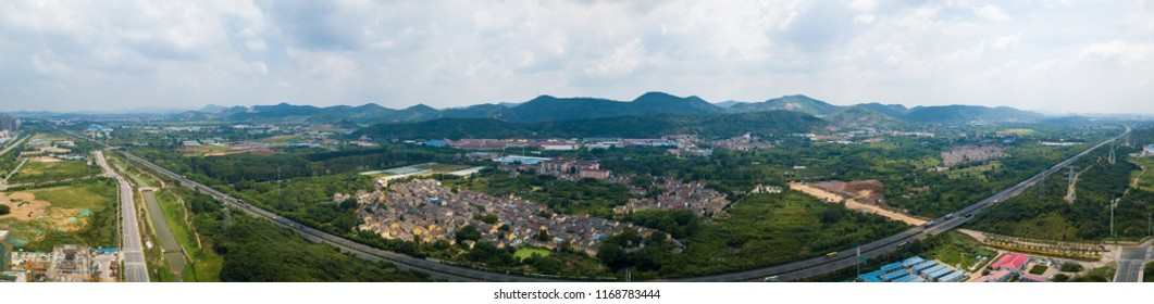 High speed and distant mountain panorama near Nanjing Qilin Gate