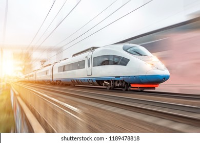 High speed fast train passenger locomotive in motion at the railway station city