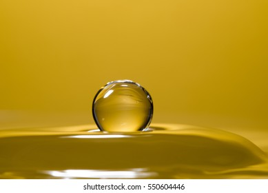 High speed macro from a waterdrop, splashing back again in the water, creating figurine like glass sculptures.