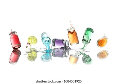 high speed photography of bottles with colorful liquid