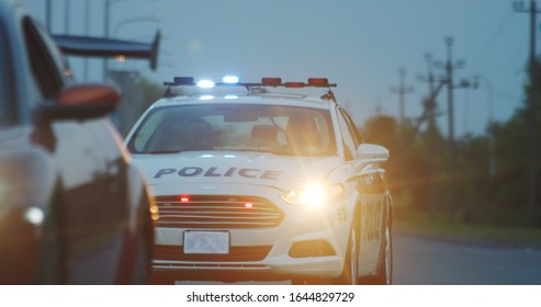 High speed police pursuit on highway. View of cop patrol car chasing a thief on red modern car driving away from the law.