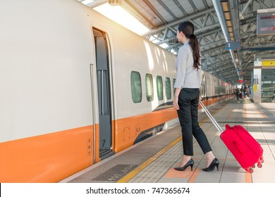 high speed rail train is arriving on the station platform and business office lady ready to get in to transport start her journey
