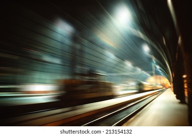 High speed railway travelling - motion blurred image of railway terminal hall
