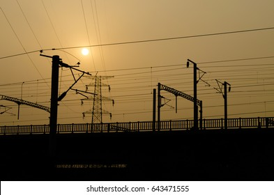 """High speed railway which connects asia and europe under the strategy of """"road and belt""""and overhead lines at sunset, Chengdu,China"""