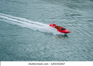 High speed red boat floats on the Danube