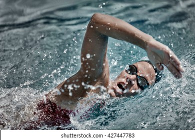 High speed swimming. Precise focus set on face, high speed desaturated film style,