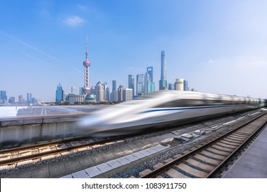 high speed train with modern building in  china