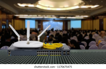 High speed Wireless technology for Conference hall is concept. Fiber optic cable and Network switch 24 port gigabit in Conference room background