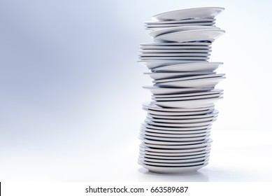 High stack of plates, isolated on white