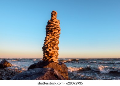 High stack of stones on the seashore in morning