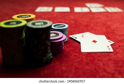 High stakes Texas hold 'em poker game on red felt at the casino