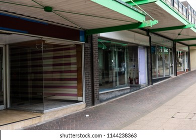 A high street in decline, Longton, Stoke on Trent, Staffordshire, derelict, abandoned shops, stores leave the high street unrecognisable, The potteries