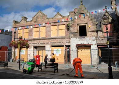 High Street, Dingwall, Inverness, Ross and Cromarty, Scotland, UK 26/09/19 In process of renovation, a view of a traditional building bearing the Masonic motif with road sweeper in action