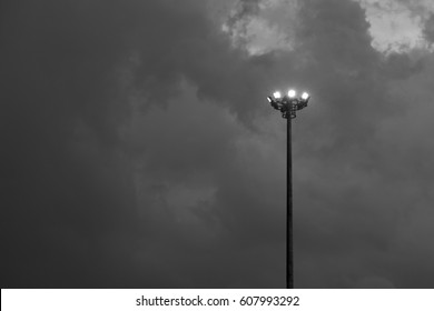 High street lamp on black sky background - black and white