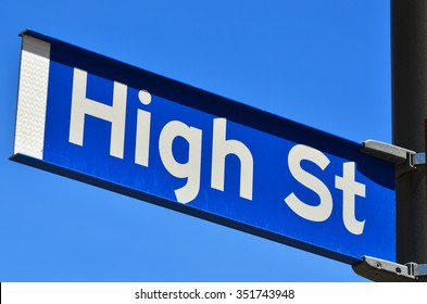High street sign on a street signpost.