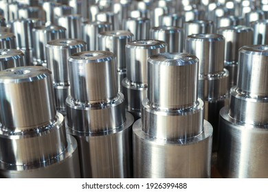 High strength metal parts turned on a lathe. Products manufactured at a metalworking plant.
