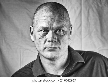 A high structure promotional head shot for an actor looking into and through the camera.
