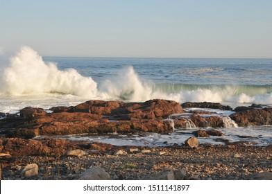 High surf from Hurricane Humberto at Bass Rocks in Gloucester, Massachusetts