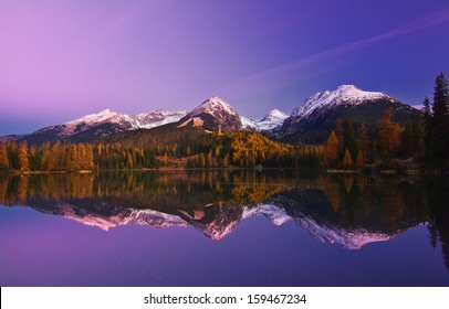 High Tatras autumn morning snowy mountains lake reflexion