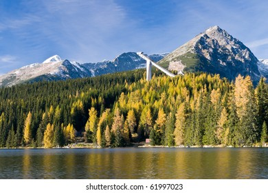 High Tatras mountains in fall with famous lake Strbske pleso in foreground, Slovakia, Europe