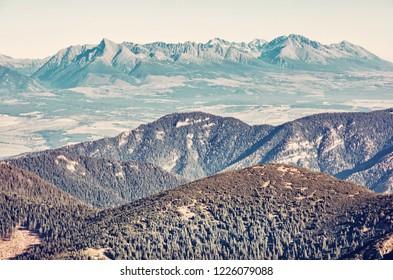 High Tatras mountains from Low Tatras, Slovak republic. Seasonal natural scene. Travel destination. Old photo filter.