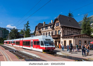 "High Tatras, Slovakia - August 27, 2015: Tatra Electric Railways (TEZ-TER) train (also known as ""Tatra tram"") arrives to Stary Smokovec station in High Tatras mountains, Slovakia"