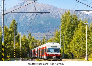 "High Tatras, Slovakia - September 19, 2018: Tatra Electric Railways (TEZ-TER) train (also known as ""Tatra tram"") arrives to Pod Lesom station in High Tatras mountains, Slovakia"