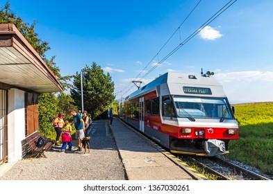 "High Tatras, Slovakia - September 19, 2018: Tatra Electric Railways (TEZ-TER) train (also known as ""Tatra tram"") arrives to Nova Lesna station in High Tatras mountains, Slovakia"