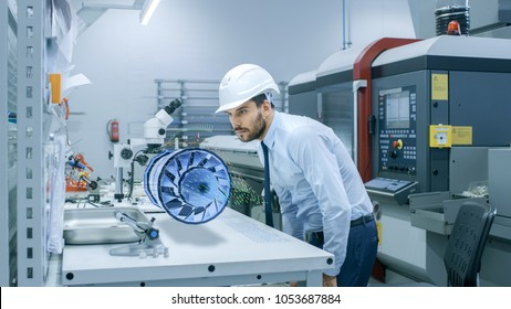 In High Tech Futuristic Factory Chief Engineer Works with Holographic Projection 3D Model of the Engine Turbine Prototype. Futuristic Desing of Virtual Mixed Reality Application.