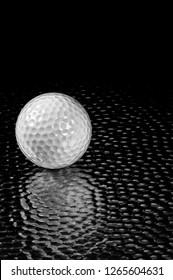 High Tech Golf Ball on Hammered sheet metal