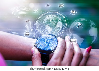 High technology digital hologram icons application  on hand watch screen while exercise lifestyle. Wireless network connection technology concept.