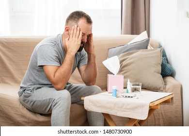 High temperature concept. Man feels badly ill. How to bring fever down. Cold symptoms and causes. Sick man with flu. High fever and headache because of influenza virus