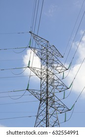 High tension eclectic power tower on ground outdoor