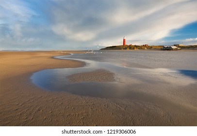 high tide on North sea coast with lighthouse, Netherlands