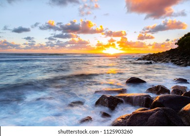 High tide at sunrise with ocean washing over the rocks at Burleigh Heads Gold Coast