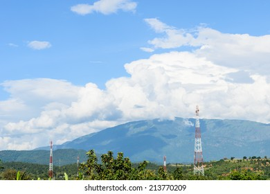 HIGH TOWER WITH ANTENNA FOR COMMUNICATION WITH   BLUE SKY AND CLOUD