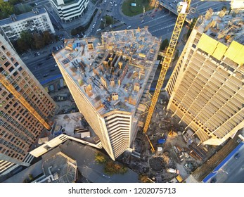 High tower building construction site. Bug industrial crane. Aerial drone view. Metropolis city development.