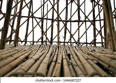 High tower structure with a bamboo that is tied together in a magical way for visitors to walk up to see the 360 ​​degree view.surrounded by scaffolding from bamboo,Bamboo panel with a rope tied const