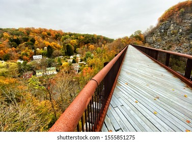 High trestle bridge above a small village during autumn in New York's Hudson valley