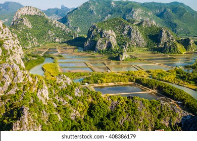 High veiw from Khao Dang view point, with shrimp farm in pond among mountain and village along the sea,Sam Roi Yot, Thailand