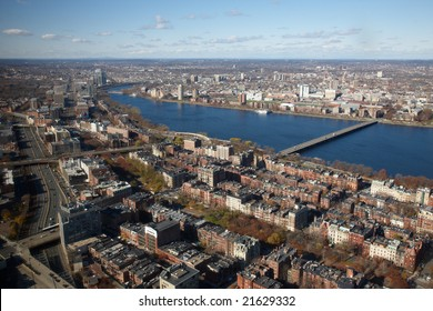 High view of Boston from From Observation Deck Of Prudential Tower. Harvard Bridge over the Charles River leads to Cambridge.