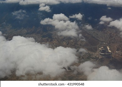 High View of Clouds and Ground from Plane