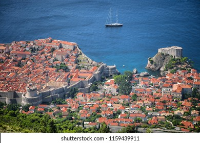 high view Dubrovnik Old Town with sail boat moored off the West Harbor, Croatia