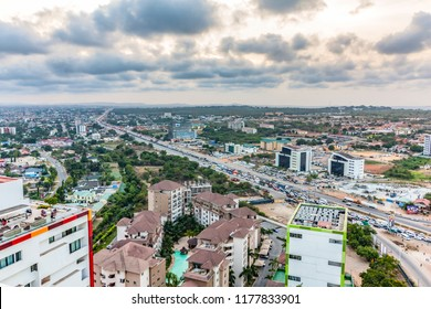 High view point cityscape of Accra, Ghana. Traffic jam on George Bush Highway with hills on the background