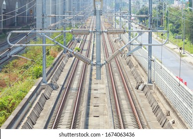High view of railway tracks with electrification pole