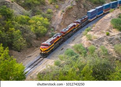high view of a train going through the desert